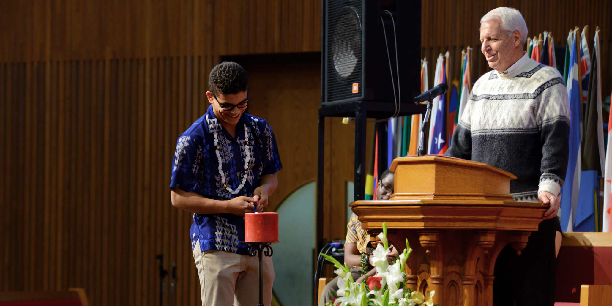 Photo of a student lighting the Sabbath Candle