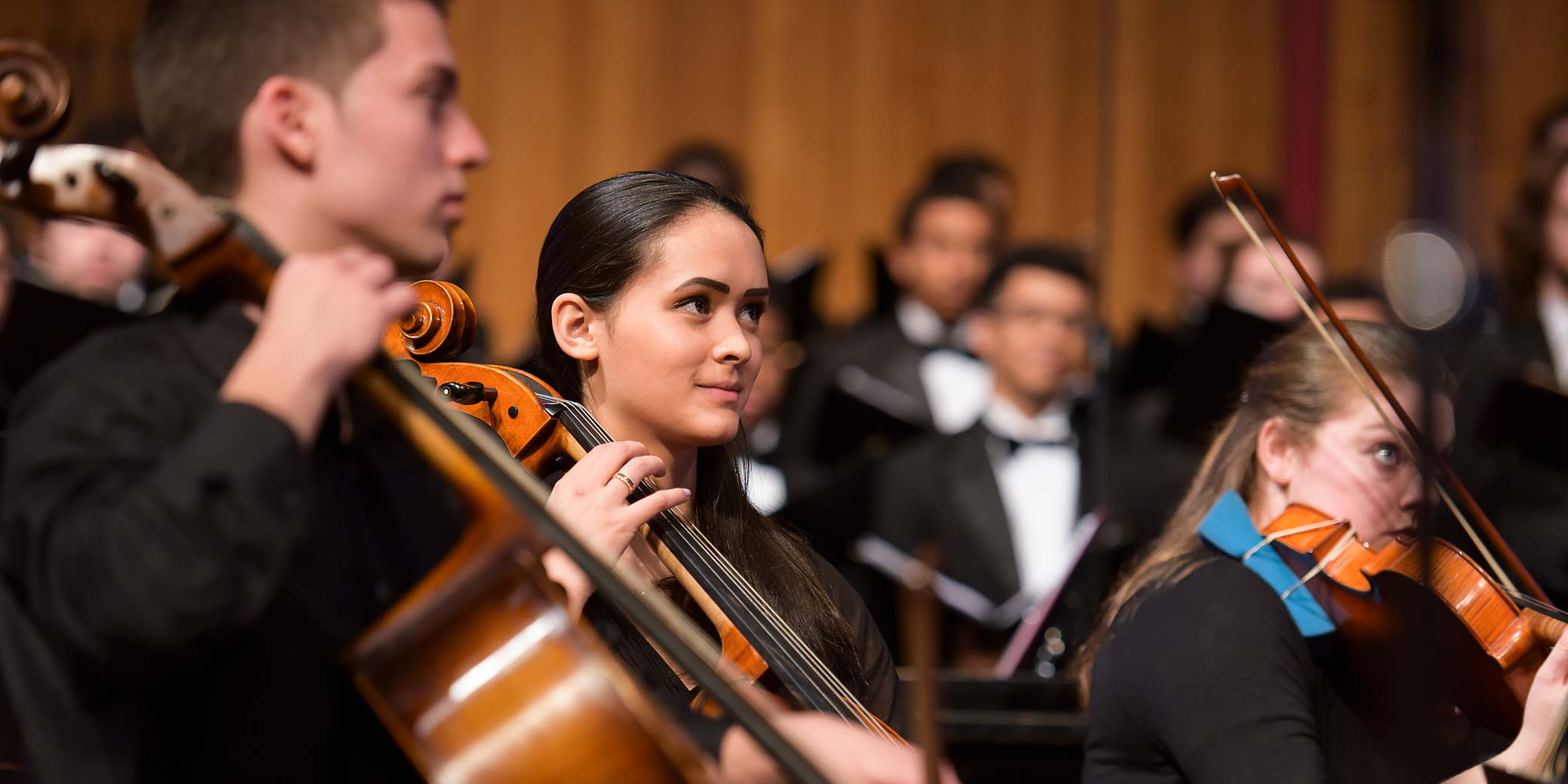 Photo of orchestra students playing cello.
