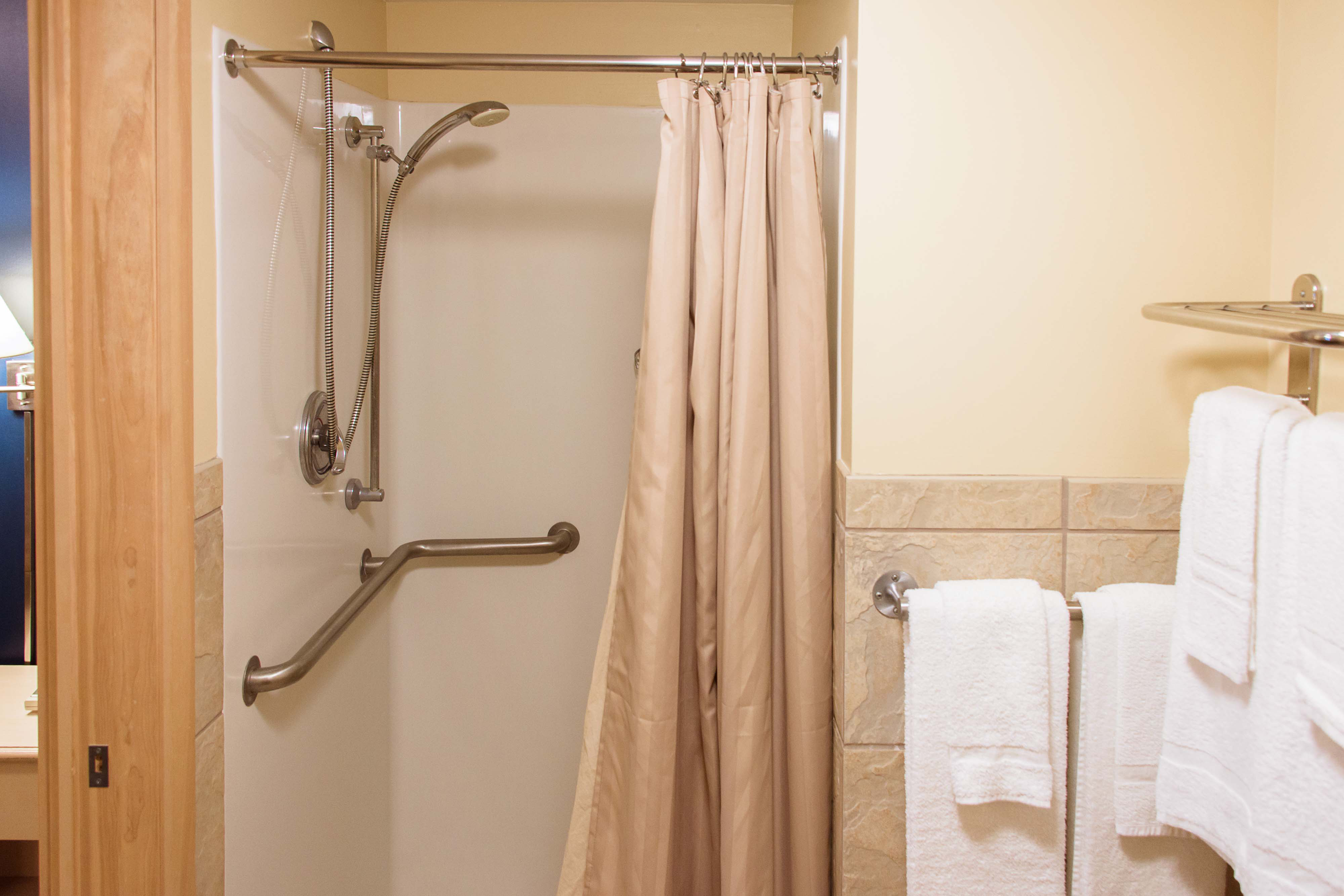 The shower and towel rack in the Ortner Center's 1-bedroom suite