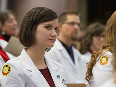 Photo of a nursing student at a white coat ceremony