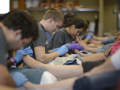 photo of students volunteering at a foot clinic