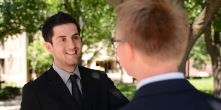 Business student shaking hands with a business professional